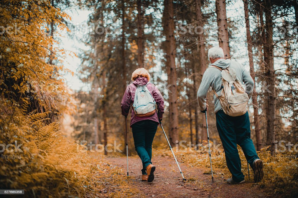Senior couple hiking stock photo