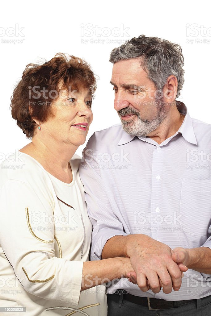 Senior couple hold for hands, hug, isolated royalty-free stock photo