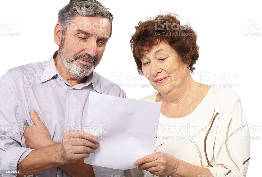 Senior couple hold paper list in hands royalty-free stock photo