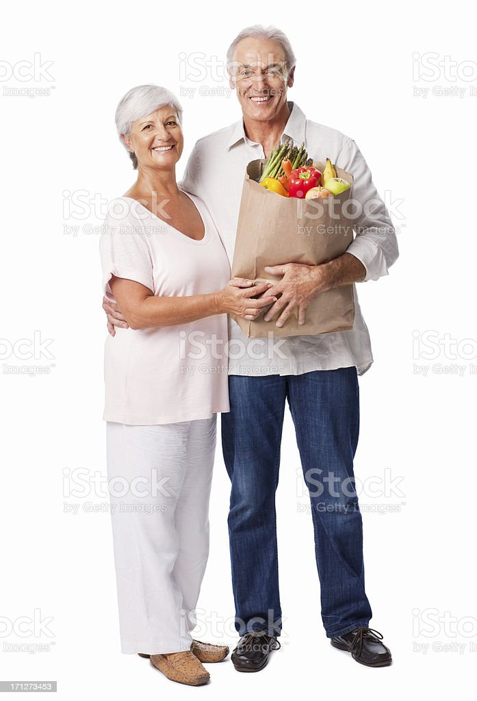 Senior Couple Holding a Bag Of Organic Produce - Isolated royalty-free stock photo