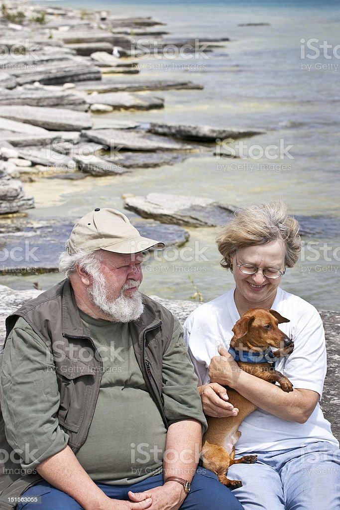 Senior couple holding a dachshund royalty-free stock photo