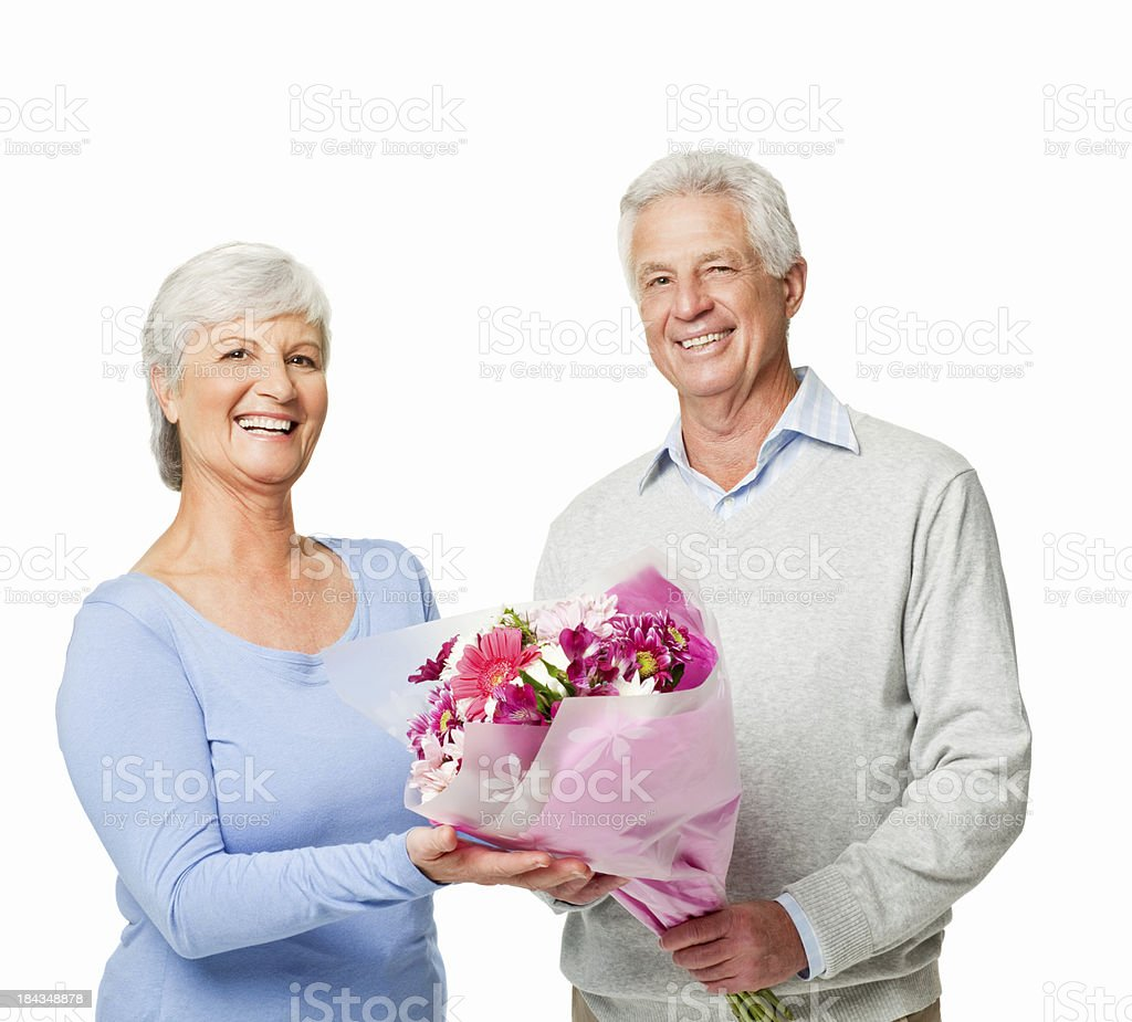 Senior Couple Holding Flowers - Isolated royalty-free stock photo