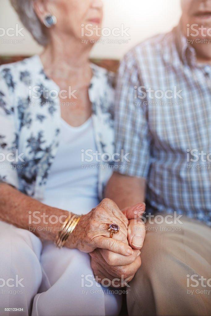 Senior couple holding hands stock photo