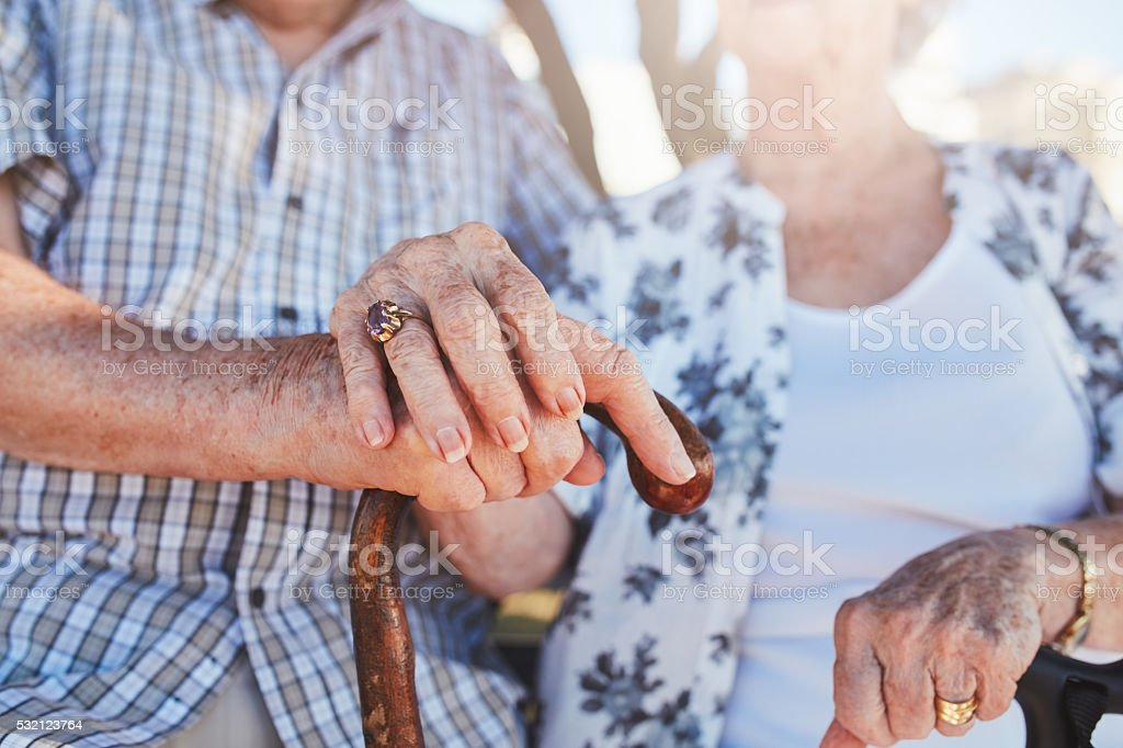 Senior couple holding hands stock photo