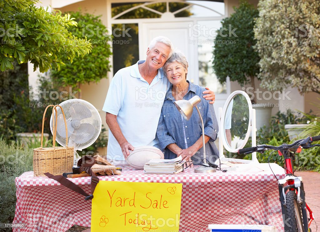 Senior Couple Holding Yard Sale stock photo