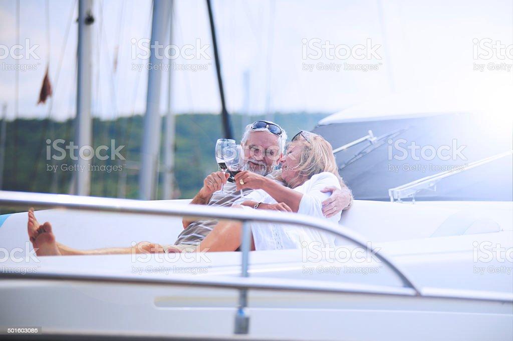 Senior couple hugging on vacation stock photo