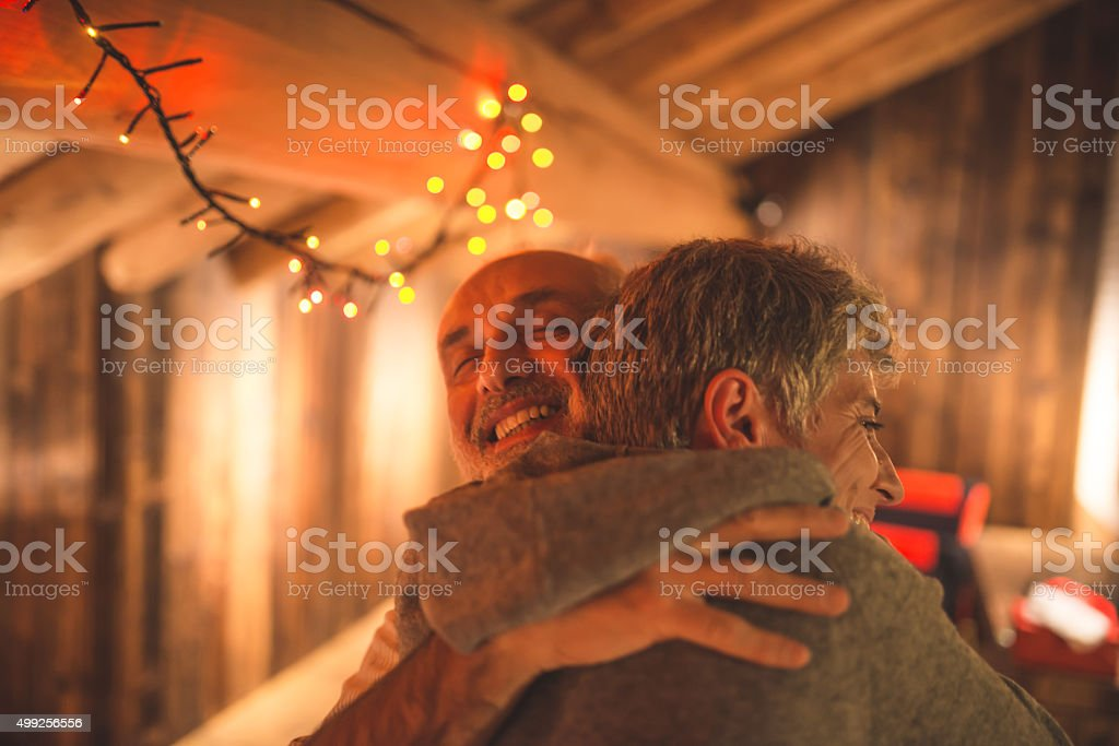 Senior couple hugging stock photo