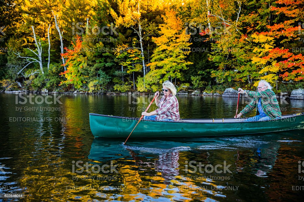 Senior couple in a canoe in Canada stock photo