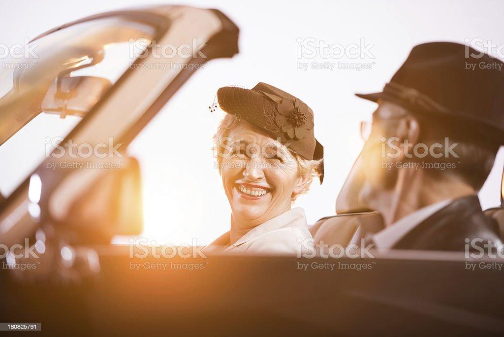 Senior couple in a convertible car. royalty-free stock photo
