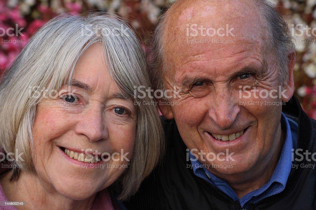 Senior couple in a garden situation royalty-free stock photo