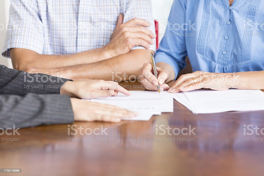 Senior Couple In A Meeting With Financial Advisor. royalty-free stock photo