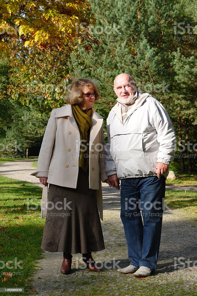 Senior couple in an autumn park royalty-free stock photo