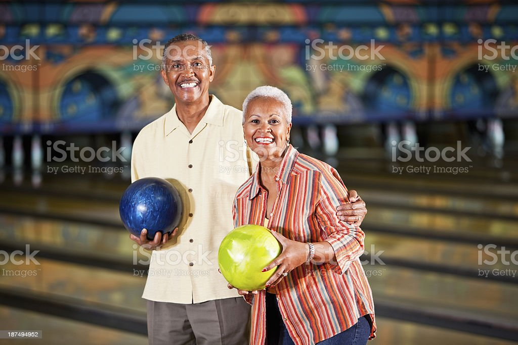 Senior couple in bowling alley stock photo