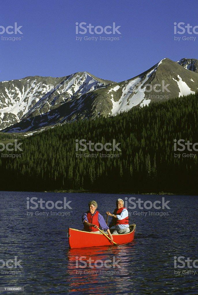 Senior Couple in Canoe on Lake royalty-free stock photo
