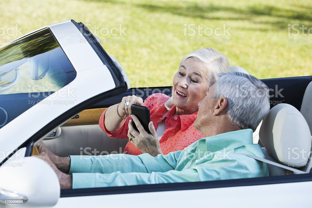 Senior couple in convertible royalty-free stock photo