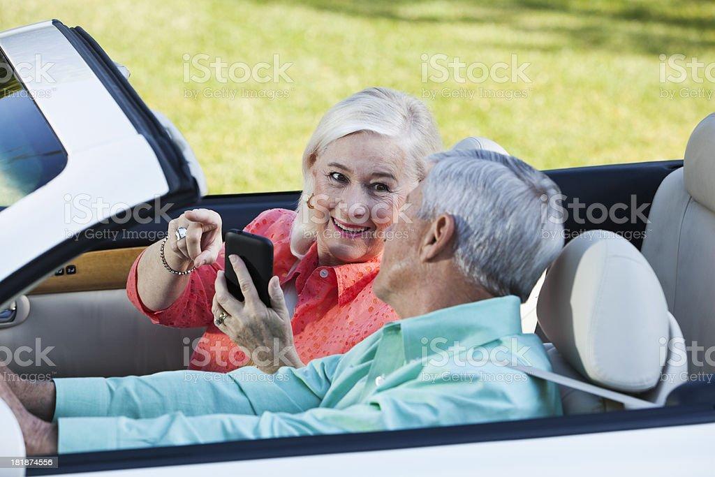 Senior couple in convertible stock photo