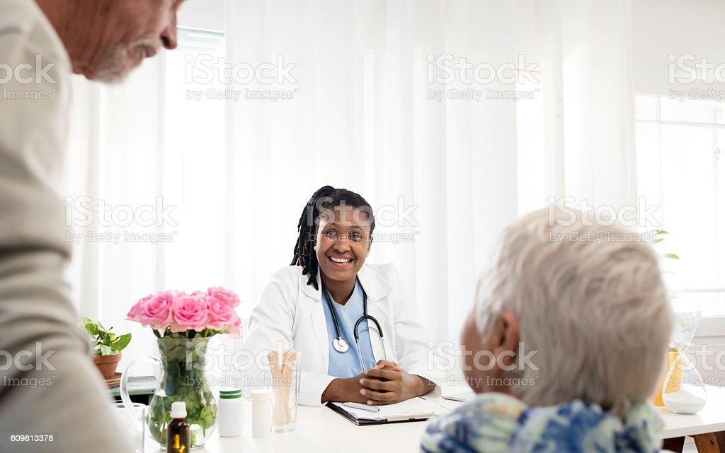 Senior Couple In Doctors Consultation Room stock photo