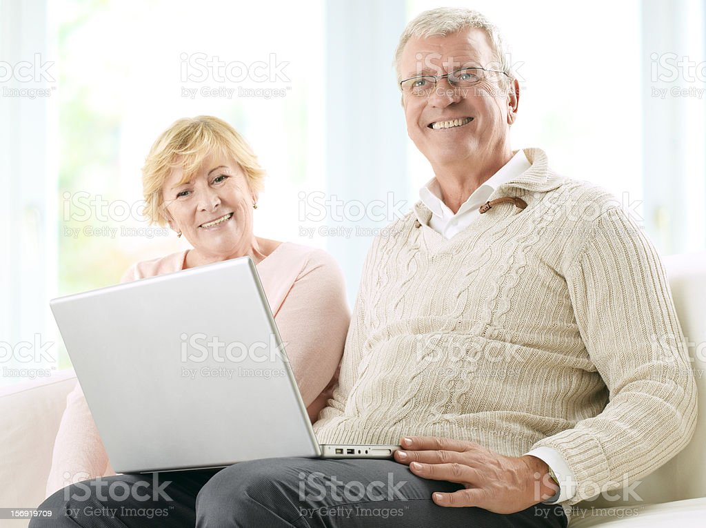 Senior couple in front of a laptop royalty-free stock photo