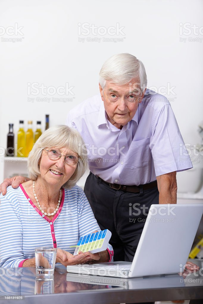 Senior Couple In Front Of  The Laptop royalty-free stock photo