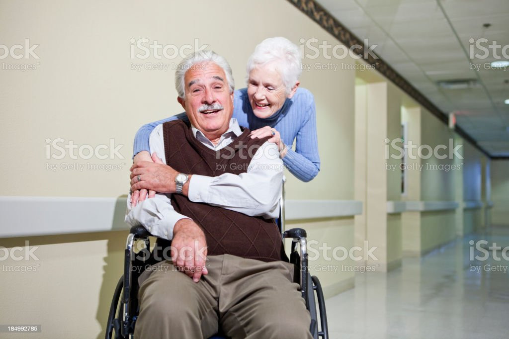 Senior couple in hospital corridor stock photo