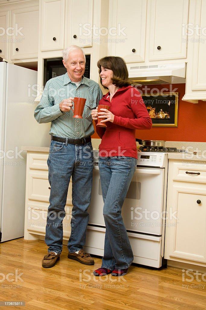 Senior couple in kitchen royalty-free stock photo