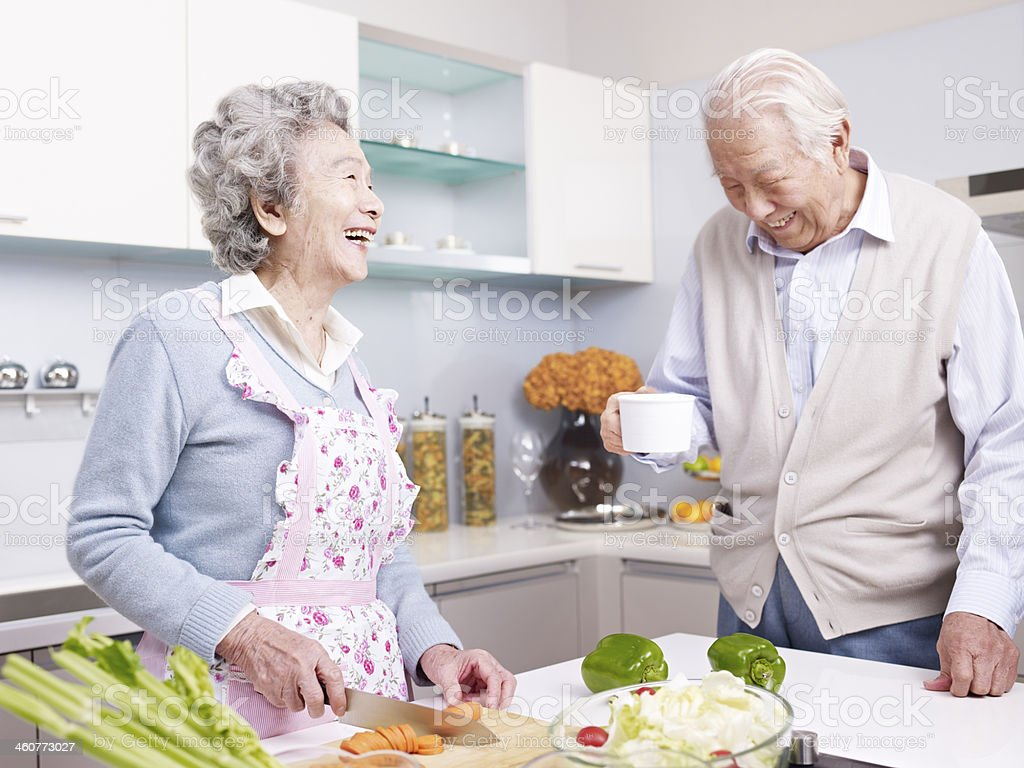 senior couple in kitchen stock photo
