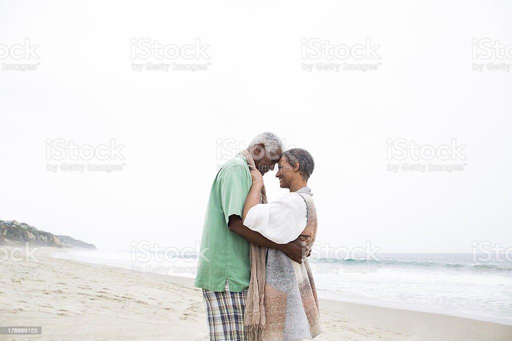 Senior couple in love enjoying the beach royalty-free stock photo