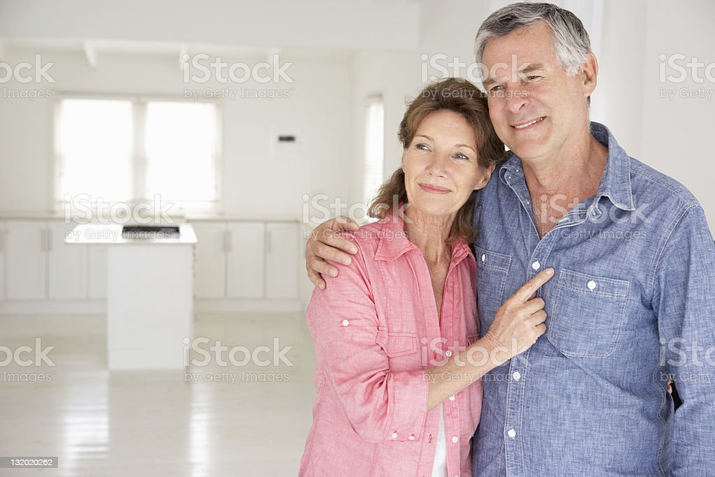 Senior couple in new home royalty-free stock photo