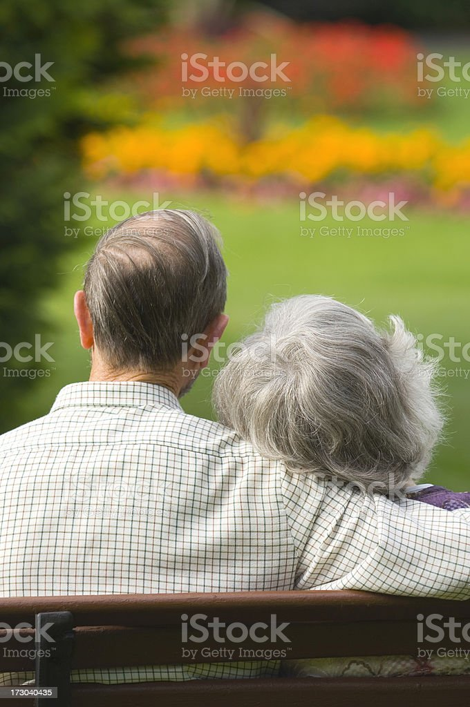 Senior couple in park royalty-free stock photo