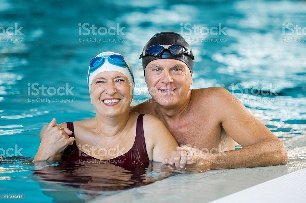 Senior couple in pool stock photo