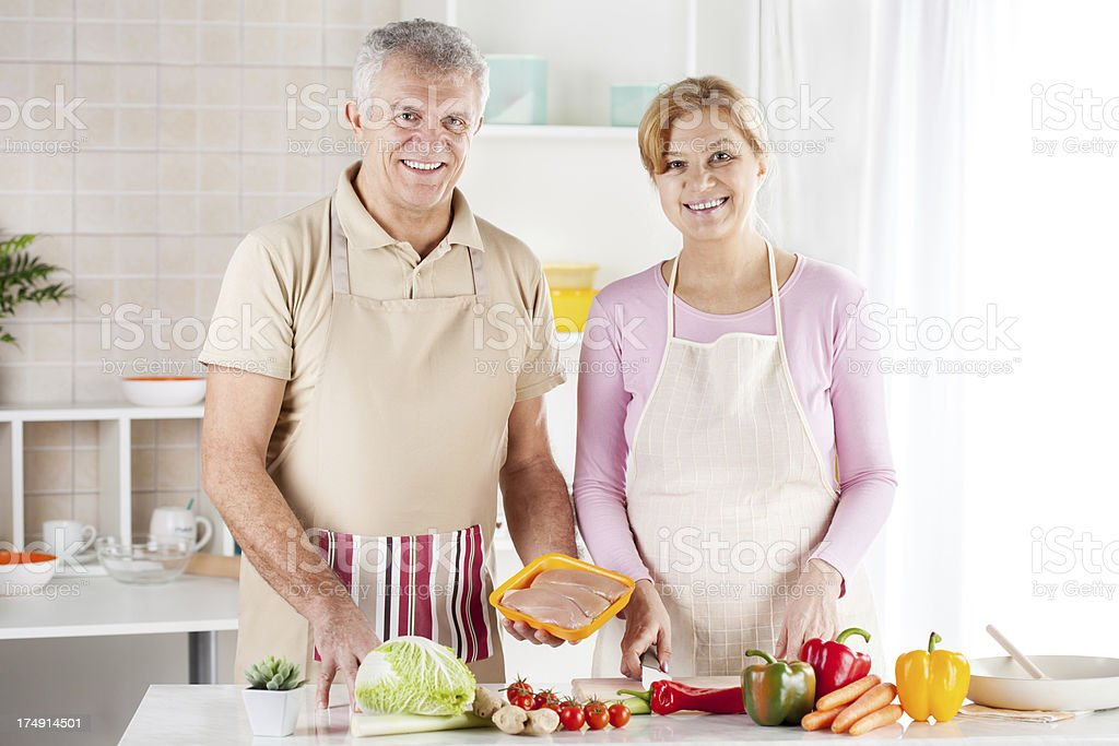 Senior Couple in the kitchen royalty-free stock photo