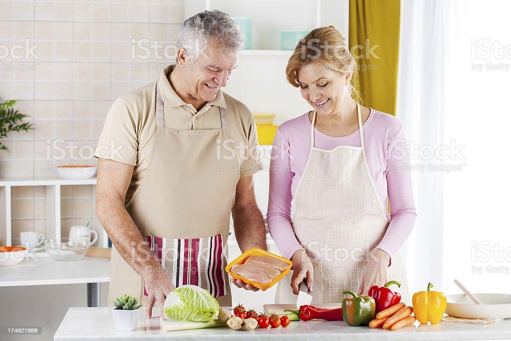 Senior Couple in the kitchen royalty-free stock photo
