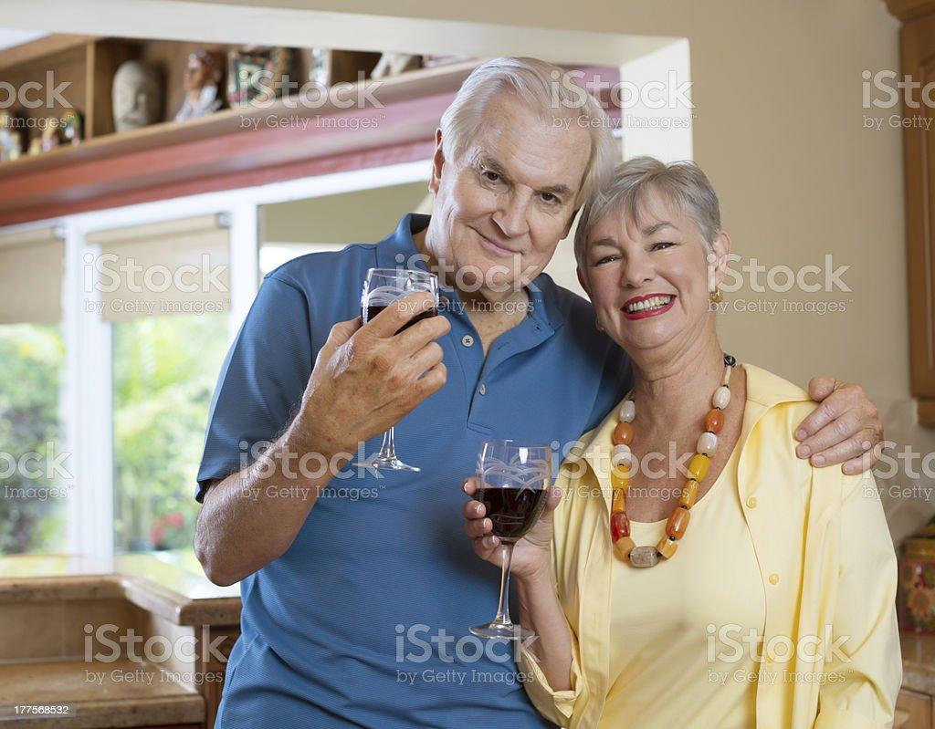 senior couple in the kitchen stock photo