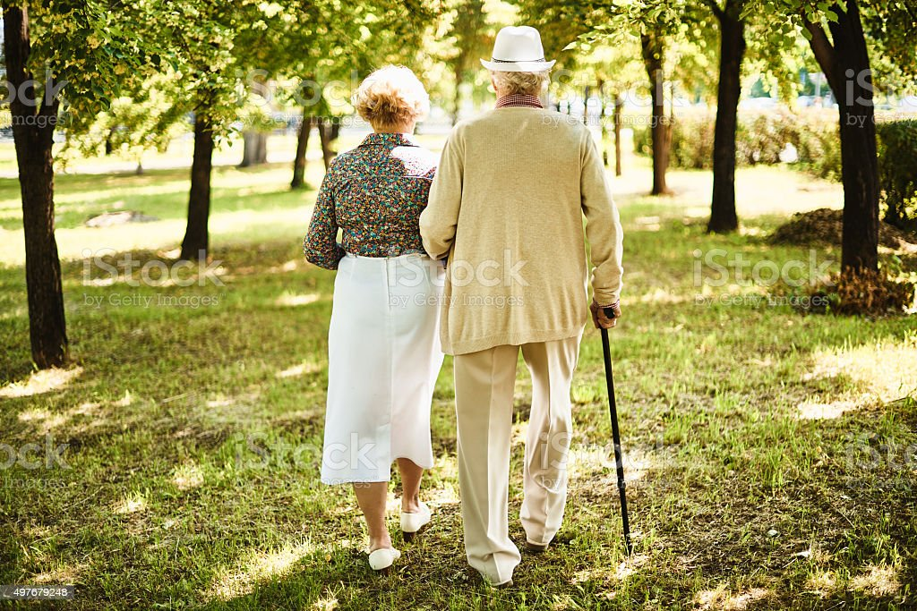Senior couple in the park stock photo
