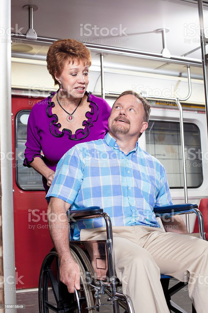 Senior Couple in the Subway - Disability Accessible royalty-free stock photo