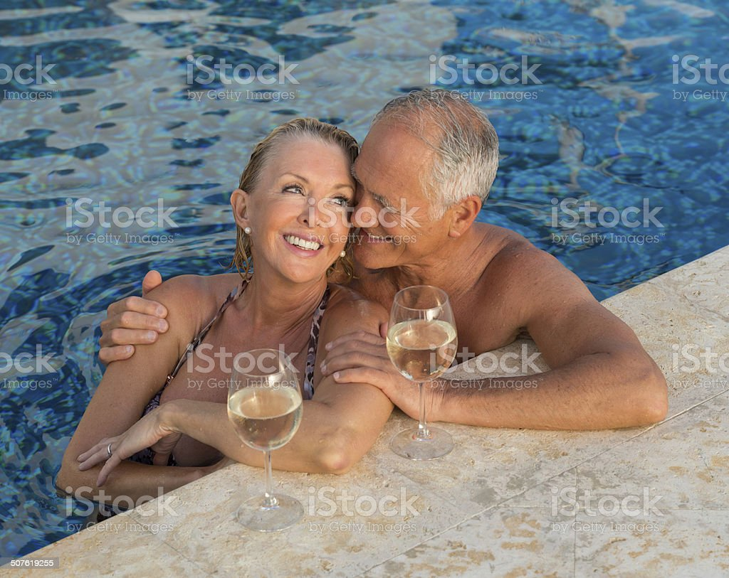 Senior Couple In The Swimming Pool royalty-free stock photo