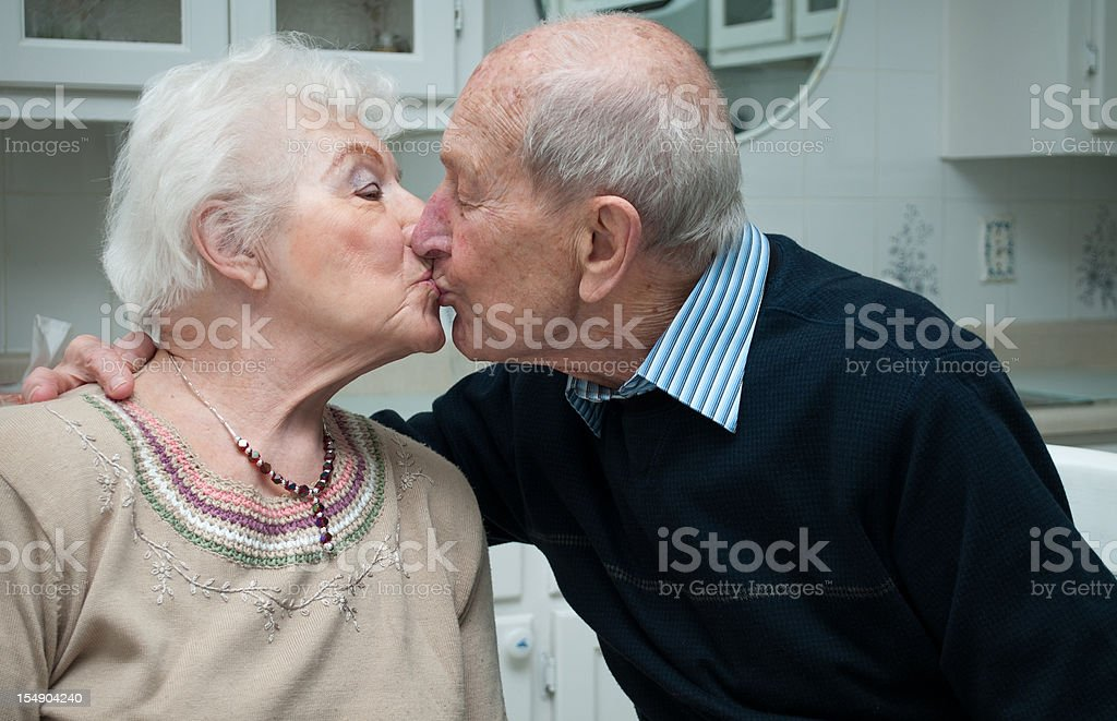 Senior couple in their eighties married 67 years kissing royalty-free stock photo
