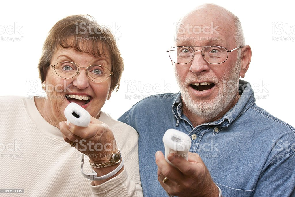 A senior couple interacting with video game controllers  royalty-free stock photo