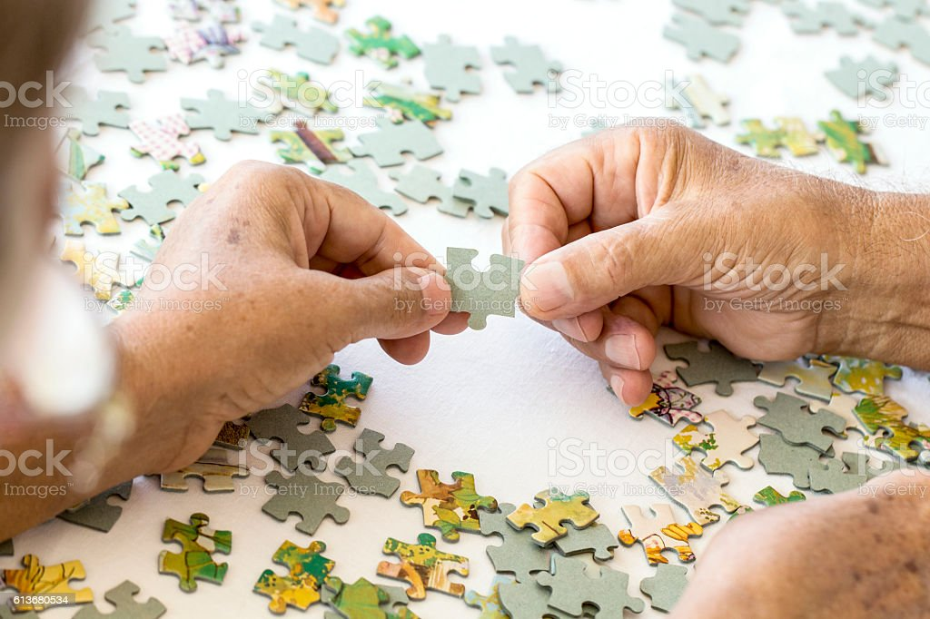 Senior Couple is Playing Puzzle. stock photo