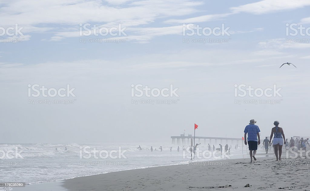 senior couple is walking at the beach royalty-free stock photo