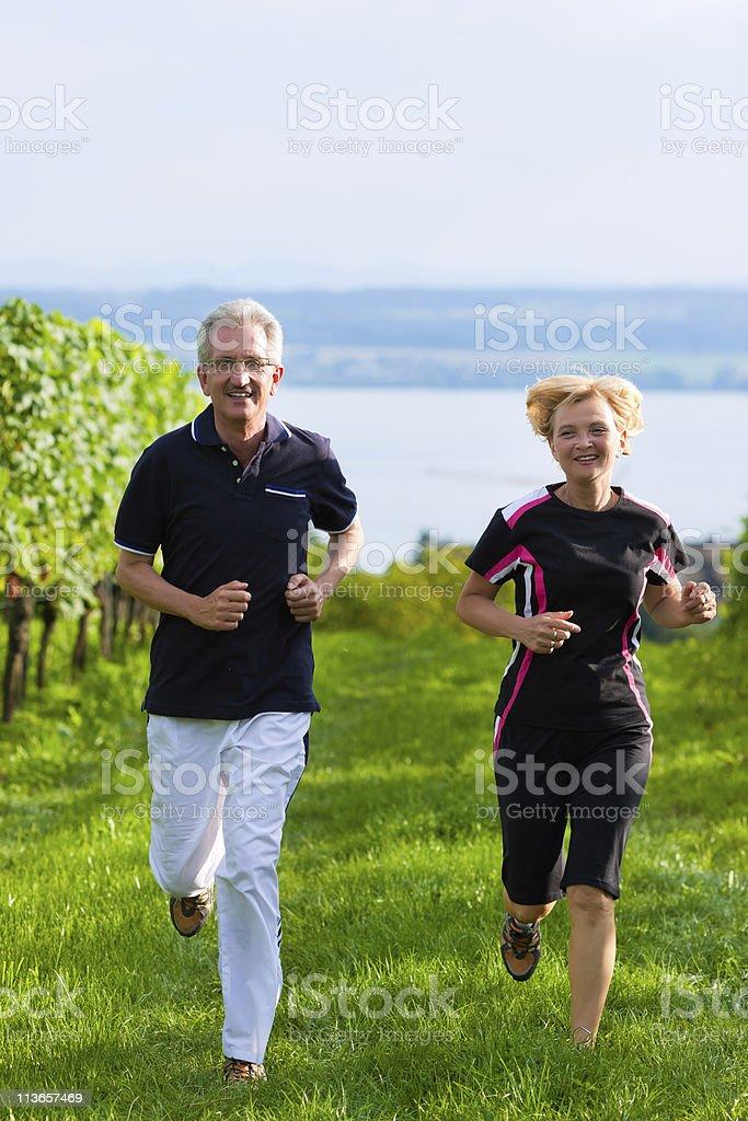 Senior couple jogging for sport royalty-free stock photo