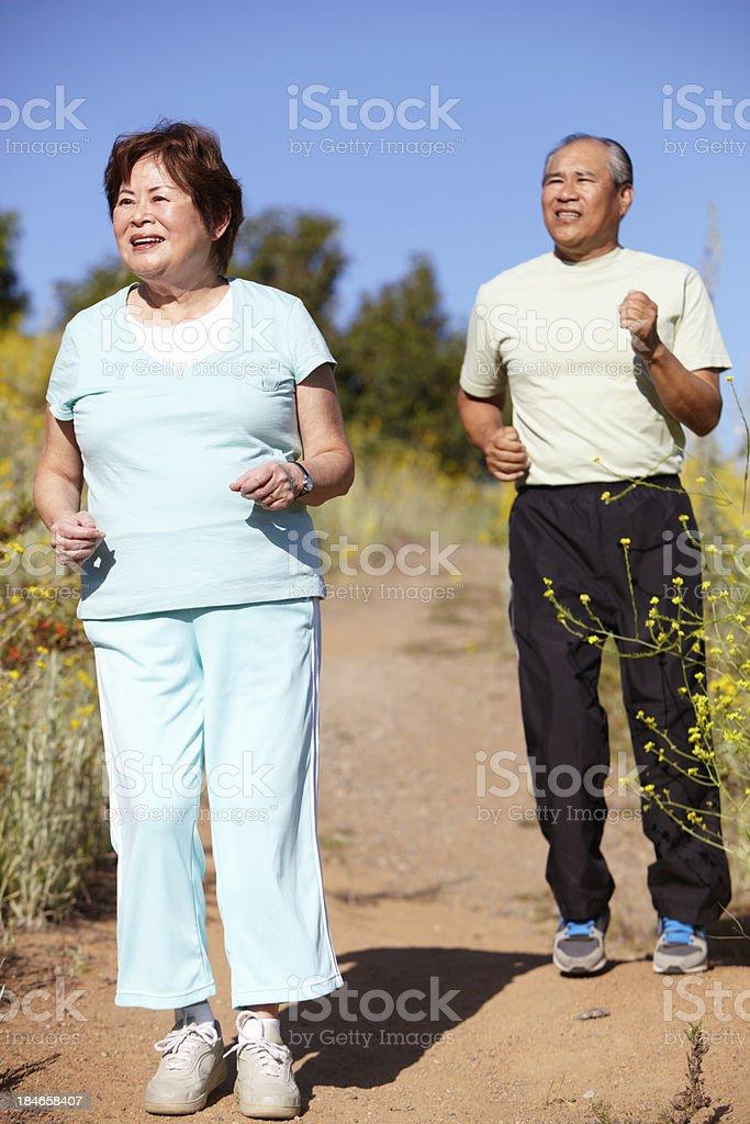 Senior couple jogging royalty-free stock photo