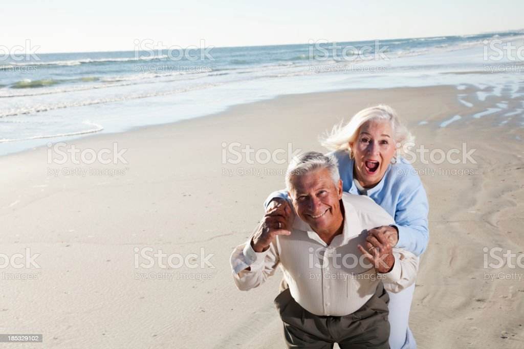 Senior couple laughing on beach royalty-free stock photo