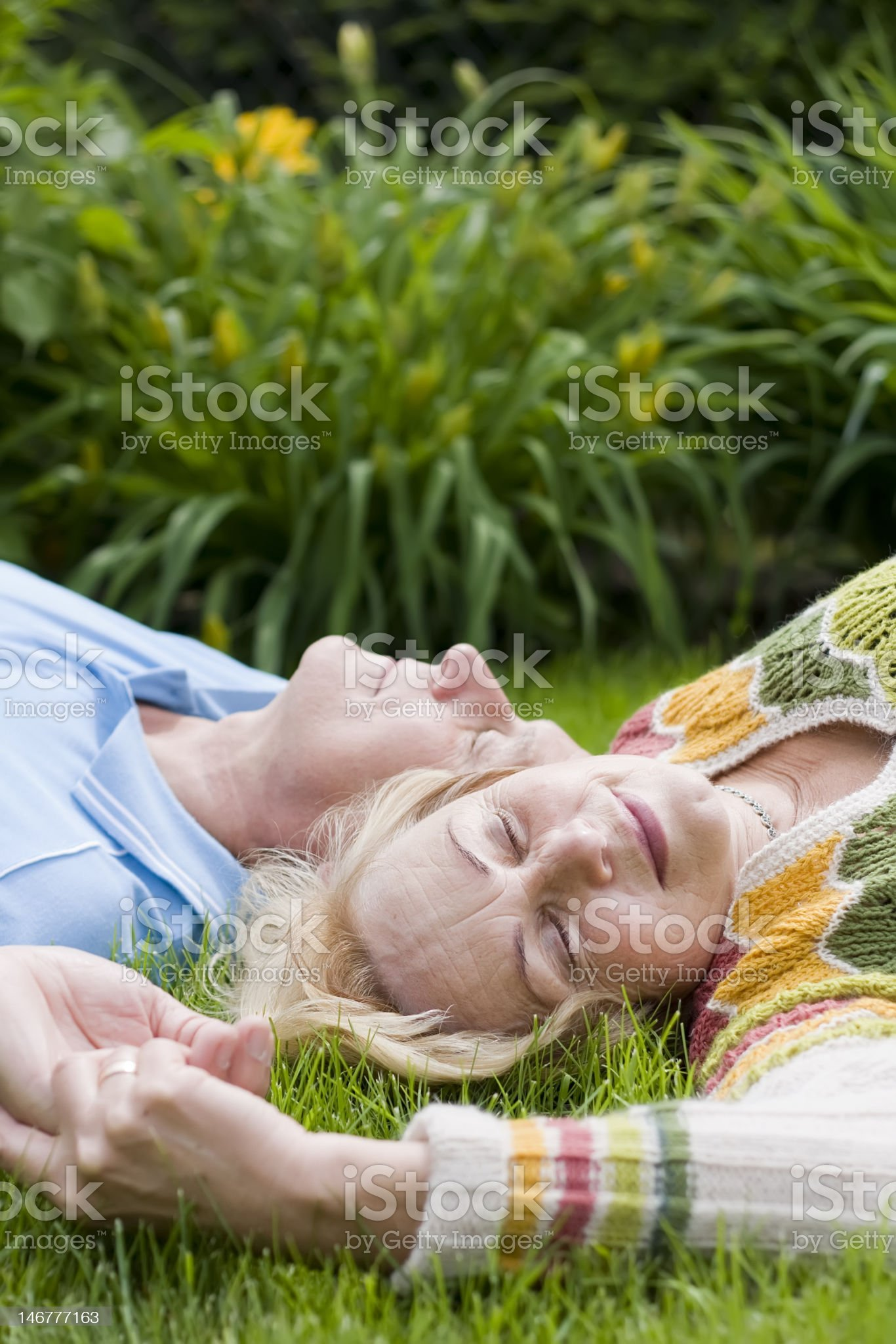 Senior couple laying on the grass royalty-free stock photo