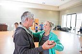 Senior couple learns to ballroom dance