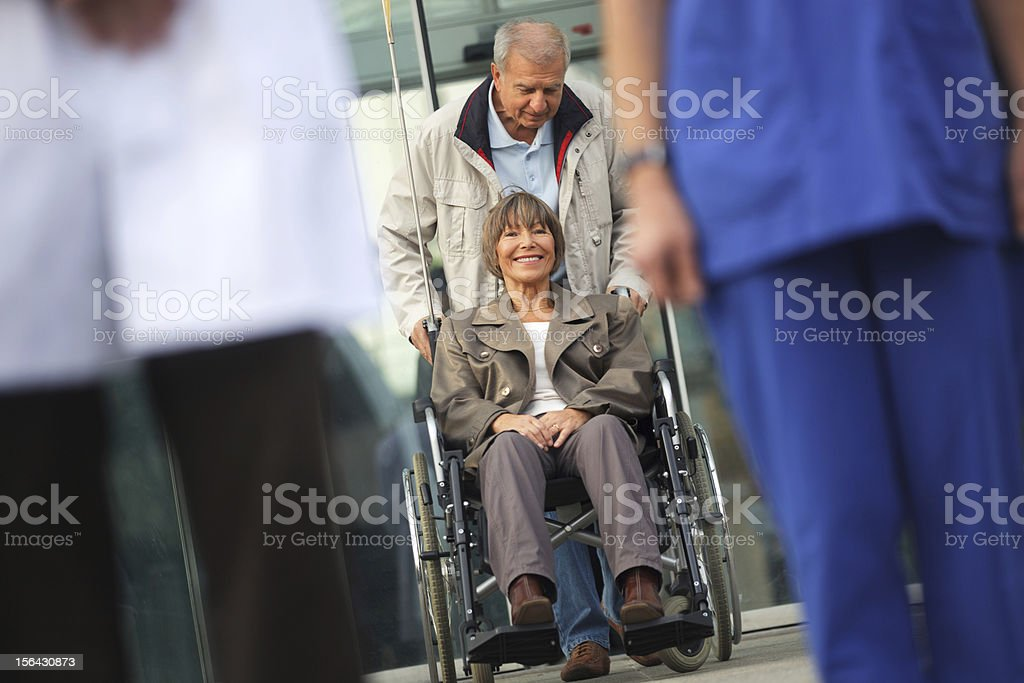 Senior couple leaving the Hospital stock photo