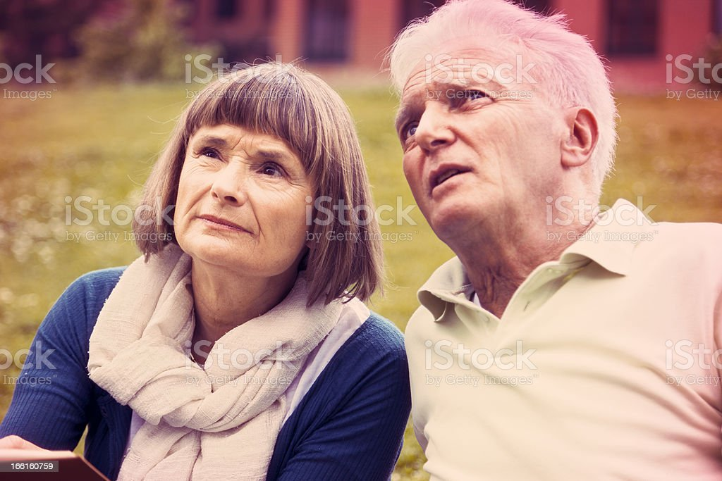 Senior Couple Leisure Time at the Park - Cross Process royalty-free stock photo