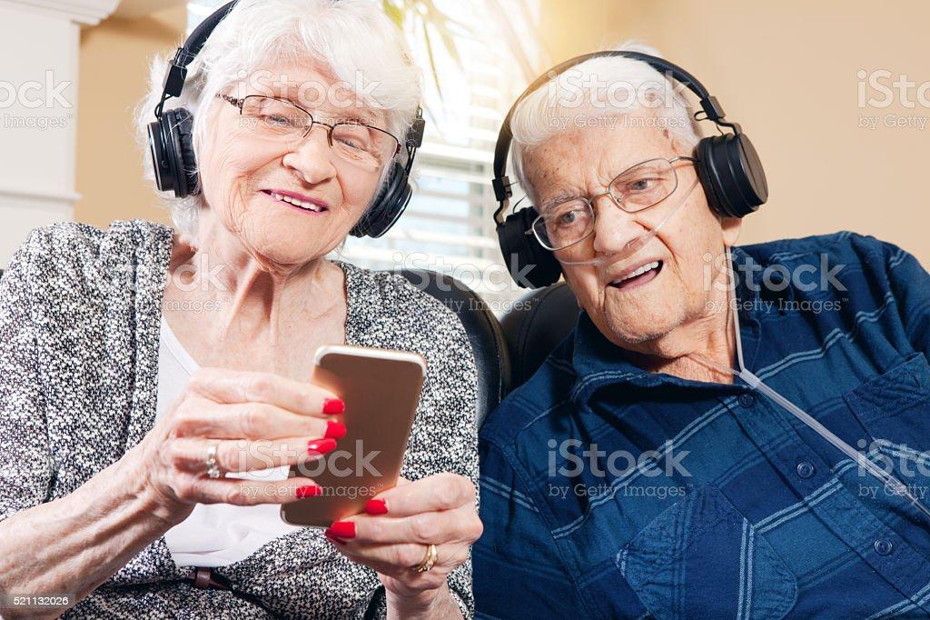 Senior Couple Listening To Music stock photo