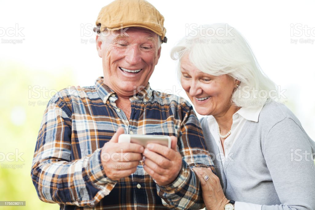 Senior couple looking at mobile phone royalty-free stock photo