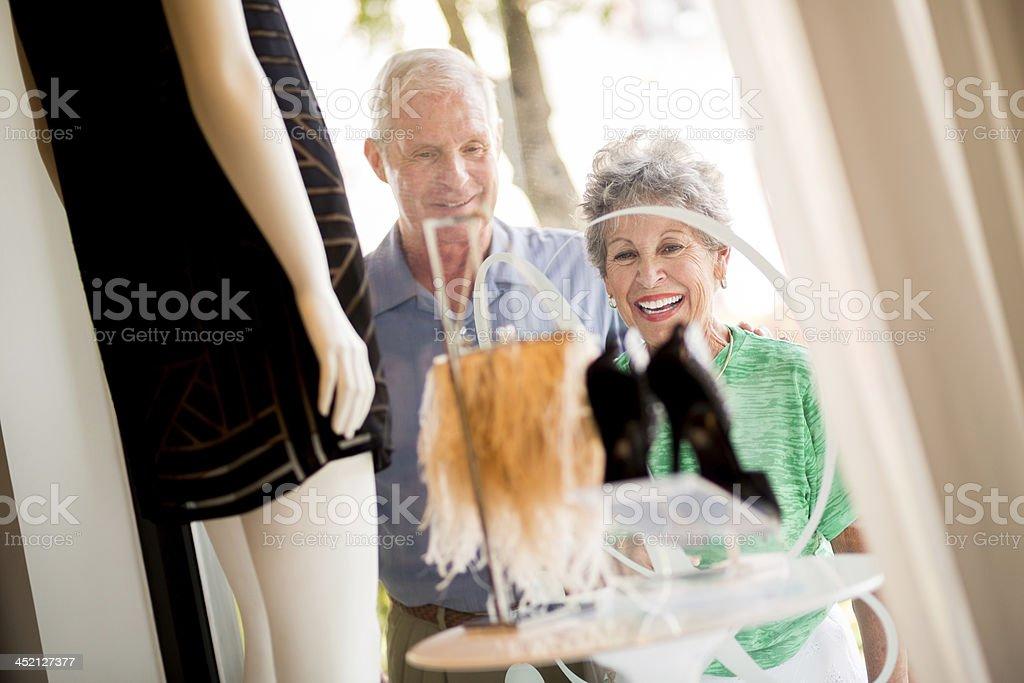 Senior Couple Looking Into Store stock photo